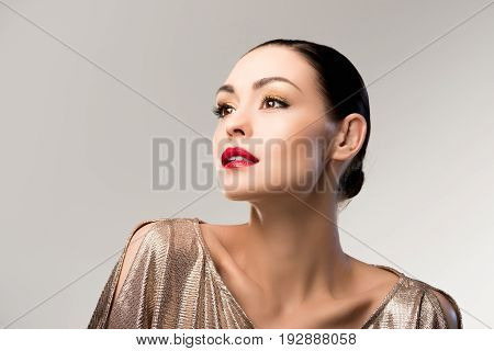 Portrait Of Sensual Woman With Bright Makeup Looking Away Isolated On Grey