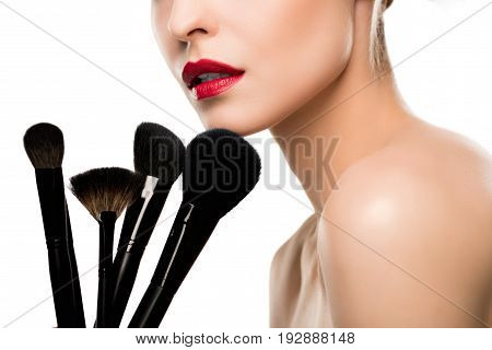 Cropped Shot Of Sensual Young Woman Holding Makeup Brushes Isolated On White