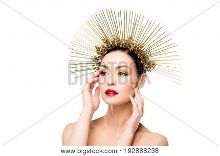 Glamorous Model Posing In Golden Headpiece And Touching Her Face Isolated On White