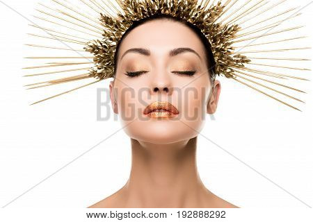 Sensual Woman In Golden Headpiece Posing With Closed Eyes Isolated On White