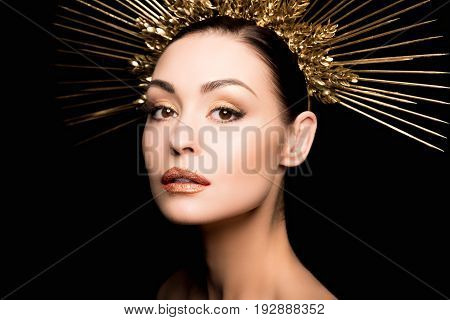 Portrait Of Gorgeous Woman In Golden Headpiece Looking At Camera Isolated On Black