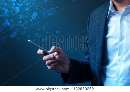 Businessman sending bulk messages using smartphone male business person in elegant suit delivering e-mails newsletters or SMS text messages with his mobile phone app poster