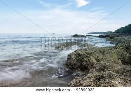 waves hitting the rocks at the beach.It was taken with slow shutter speed