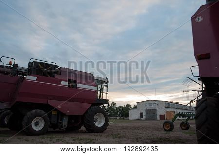 Red Harvester On The Background Of The Sky,
