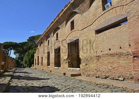 The ruins insulae apartment buildings in Ostia Antica near Rome Italy. It was Rome's ancient port before the river silted it fell into decay with the end of the Roman empire and was abandoned in the 9th century.