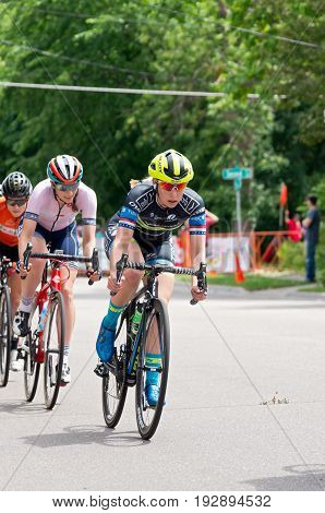 STILLWATER, MINNESOTA/USA - JUNE 18, 2017: Pro women cyclists on course at the 2017 North Star Grand Prix Stillwater Criterium. It is the final stage of a six-stage annual race event.