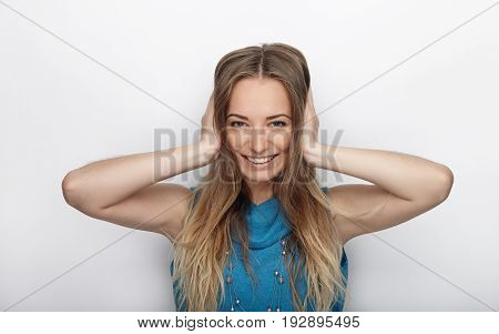 Headshot Of Young Adorable Blonde Woman With Cute Smile On White Background Covers Her Ears With Pal