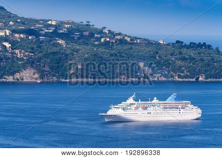 Salerno Italy - June 11 2016: Cruise ship sails into the harbor of Salerno from the Mediterranean sea filled with passengers destined to visit the Amalfi Coastline in Italy.