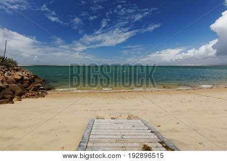 Pathway to the beach on Culatra Island in Ria Formosa Natural Park, Portugal