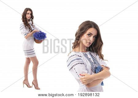 Pretty Ukrainian woman with gum of cornflowers isolated over white background
