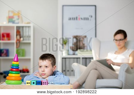 Professional therapist and her autistic patient during a meeting