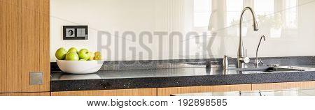 Worktop of modernly designed bright kitchen interior