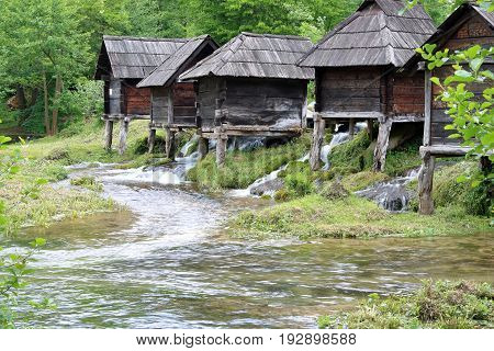Wooden huts housing the traditional watermills at Pliva Lake Bosnia and Herzegovina