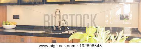 Bright open plan kitchen interior with marble worktop