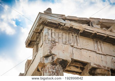 Part of the Parthenon frieze against the blue sky. Ancient Greek temple Parthenon in Athens Greece.