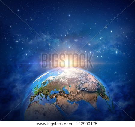 Planet Earth in deep space star cluster and milky way far behind sunrise shining on the horizon - 3D illustration Elements of this image furnished by NASA