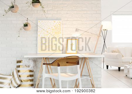 Artist's atelier with a cozy living room space poster