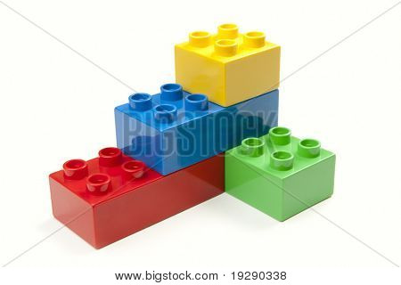 Bright Color Building Blocks Isolated on White. Focus on near edge of bricks with selective focus