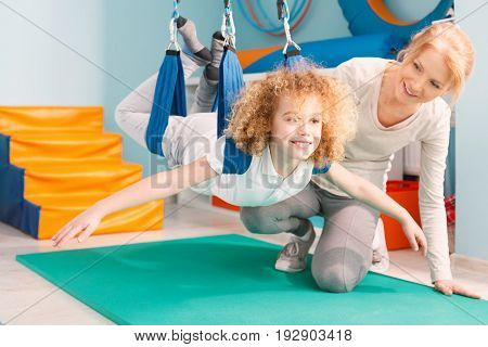 Boy and his therapist exercising during sensory integration therapy