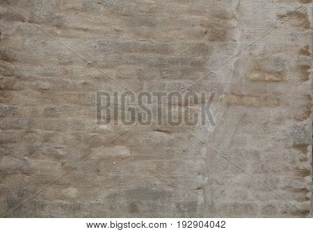 Wall Of Rough Beige Brown Plaster Over Bricks