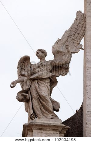 ROME, ITALY - SEPTEMBER 01: Angel on the portal of Sant Andrea della Valle Church in Rome, Italy on September 01, 2016.