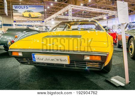 MAASTRICHT NETHERLANDS - JANUARY 14 2016: Sports car Ferrari 308 GT4 Dino 1977. International Exhibition InterClassics & Topmobiel 2016
