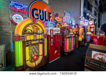 MAASTRICHT NETHERLANDS - JANUARY 14 2016: Various retro jukeboxes and retro refrigerator Coca-Cola. International Exhibition InterClassics & Topmobiel 2016