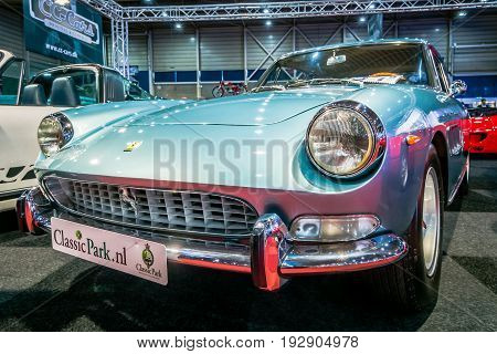 MAASTRICHT NETHERLANDS - JANUARY 14 2016: Sports car Ferrari 330 GT 2+2 Series II 1967. International Exhibition InterClassics & Topmobiel 2016