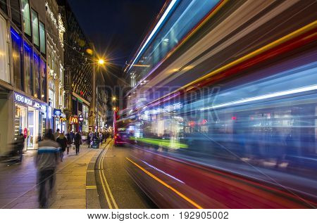 London UK October 05 2016: Crowded Oxford street with city bus passing by at night