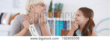 School counsellor training with girl with articulation problem mouth system