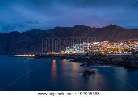 Night landscape of Los Gigantes, popular Tenerife resort. View from the water. Canary islands, Spain.