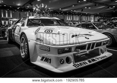 MAASTRICHT NETHERLANDS - JANUARY 14 2016: Sports car BMW M1 Procar (racing version of the BMW M1) 1980. Black and white. International Exhibition InterClassics & Topmobiel 2016