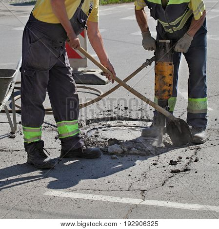 Asphalt Demolishing, Worker And Jackhammer