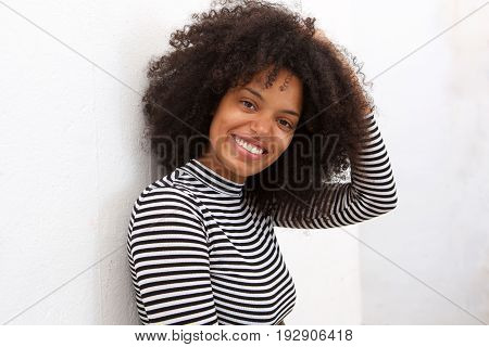 Close Up Beautiful African American Woman With Hand To Curly Hair