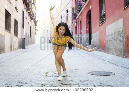 Young Attractive Latin Woman Happy And Excited Posing On Modern Urban European City