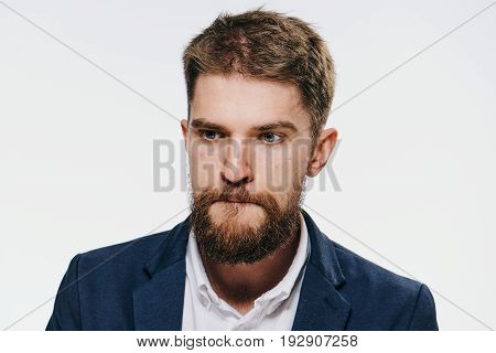 Business man with beard on white isolated background, portrait, emotion.