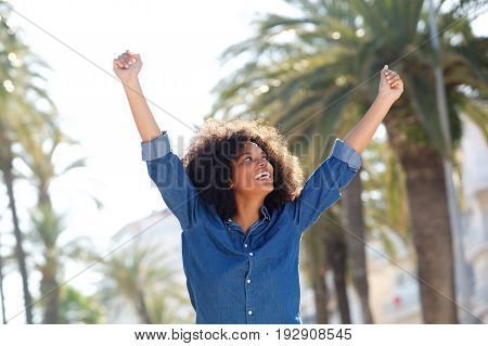 Joyful Woman Outside With Arms Outstretched
