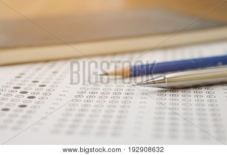 close up soft focus on Clutch-type pencil lay on exam test paper:blur picture concept.