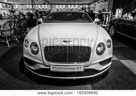 MAASTRICHT NETHERLANDS - JANUARY 14 2016: Personal luxury car Bentley Continental GT V8S since 2016. Black and white. International Exhibition InterClassics & Topmobiel 2016