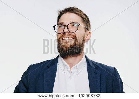 Businessman with a beard in glasses on a white isolated background.