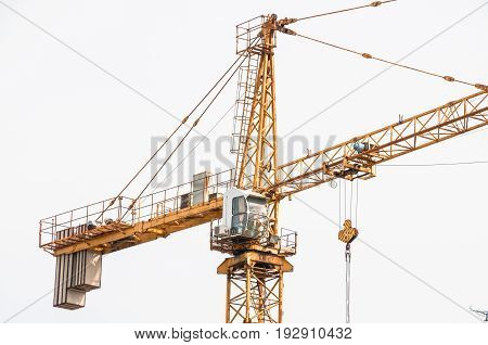 Cab lifting crane in the construction site. Building