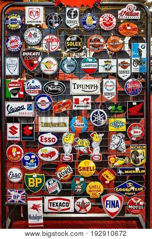 MAASTRICHT NETHERLANDS - JANUARY 14 2016: Background of logos from different manufacturers of automotive and motorcycle equipment and machinery. International Exhibition InterClassics & Topmobiel 2016
