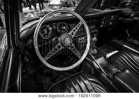 MAASTRICHT NETHERLANDS - JANUARY 14 2016: Cab of a sports car Jaguar E-Type. Black and white. International Exhibition InterClassics & Topmobiel 2016