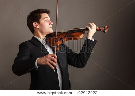 Man Man Dressed Elegantly Playing Violin