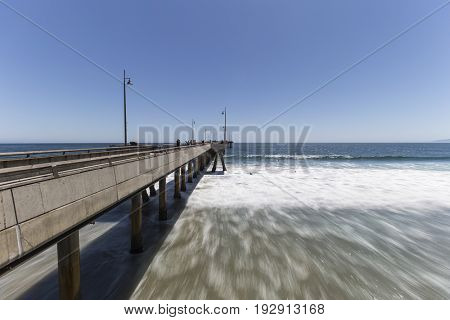 Los Angeles, California, USA - June 26, 2017:  Venice beach pier with motion blur water in Southern California.