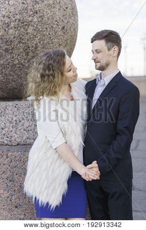 Bride and groom hold hands (Saint Petersburg, Russia)