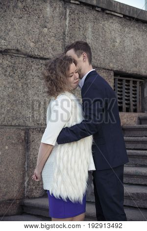 Guy is whispering in her ear to a girl (Saint Petersburg, Russia)