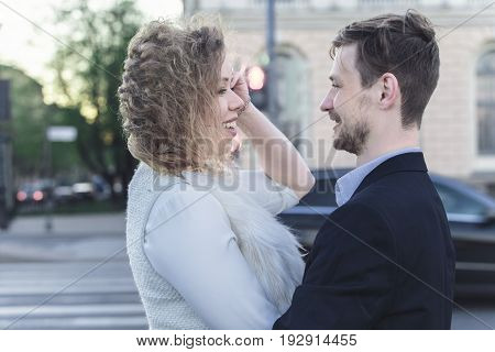 Young couple in front of a pedestrian crossing