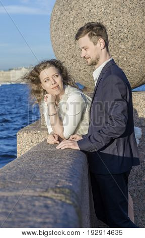 Young couple on the waterfront (Saint Petersburg, Russia)