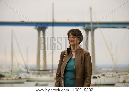 CORONADO ISLAND, CALIFORNIA, JUNE 8. Coronado Tidelands Park on June 8, 2017, on Coronado Island, California. A Woman in Coronado Tidelands Park, Coronado Island, California, the San Diego Coronado Bridge Behind.